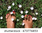 feets with red nailpolish... | Shutterstock . vector #673776853
