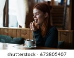 woman in a cafe  coffee         ... | Shutterstock . vector #673805407
