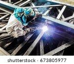 labour with welding equipment ... | Shutterstock . vector #673805977