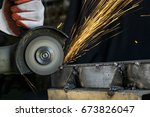 metal cutting with a rotating... | Shutterstock . vector #673826047