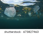 plastic carrier bags pollution... | Shutterstock . vector #673827463
