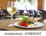 seared salmon fillet with wine... | Shutterstock . vector #673830547