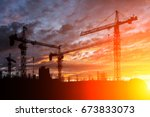 construction site at sunset | Shutterstock . vector #673833073