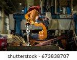 industrial robot is welding... | Shutterstock . vector #673838707