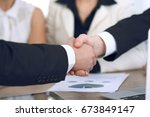 close up of business people... | Shutterstock . vector #673849147