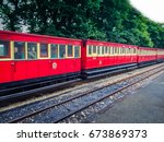 old train to railway station.... | Shutterstock . vector #673869373