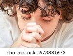 christian child boy praying....   Shutterstock . vector #673881673