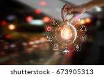 hand holding light bulb in... | Shutterstock . vector #673905313