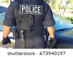 midsection of policeman in... | Shutterstock . vector #673940197