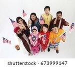 group of men and women holding...   Shutterstock . vector #673999147