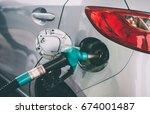 fuel pump filling a car at a... | Shutterstock . vector #674001487
