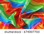 rainbow silk scarf fabric.... | Shutterstock . vector #674007703