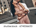 whispering about love. handsome ... | Shutterstock . vector #674036653