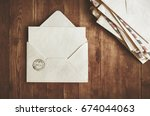 open envelope on a wooden table | Shutterstock . vector #674044063