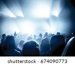 cheering crowd at rock concert... | Shutterstock . vector #674090773