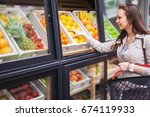 young woman buying fruit... | Shutterstock . vector #674119933