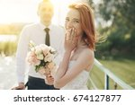 redhead bride in white dress... | Shutterstock . vector #674127877