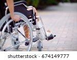 a girl with a broken leg sits... | Shutterstock . vector #674149777