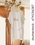 white silk robe for bride at...   Shutterstock . vector #674156287