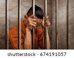 asian man in prison | Shutterstock . vector #674191057