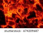 burning wood pieces   closeup... | Shutterstock . vector #674209687