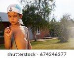 little boy holds out a... | Shutterstock . vector #674246377