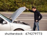 a man tries to repair the car... | Shutterstock . vector #674279773