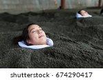 woman enjoy hot sand bath | Shutterstock . vector #674290417