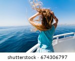 woman back on yacht looking to... | Shutterstock . vector #674306797