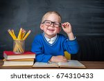 happy cute clever boy is... | Shutterstock . vector #674310433