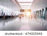 people in airport terminal... | Shutterstock . vector #674325343