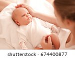 cute small baby lying on... | Shutterstock . vector #674400877