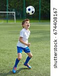 boy soccer playing with ball on ... | Shutterstock . vector #674408167