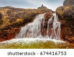 water of small waterfall  ... | Shutterstock . vector #674416753