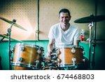 behind the scene. male drummer... | Shutterstock . vector #674468803