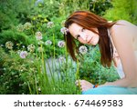 Young Lady Holds Flowers And...