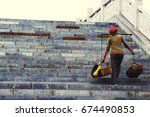 old chinese woman climb the... | Shutterstock . vector #674490853