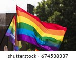 gay rainbow flag being waved at ... | Shutterstock . vector #674538337