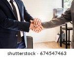 businessman and partner shaking ... | Shutterstock . vector #674547463