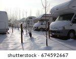 motorhome and caravan at winter ... | Shutterstock . vector #674592667