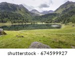 lake duisitzkarsee in styria ... | Shutterstock . vector #674599927