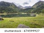 lake duisitzkarsee in styria ... | Shutterstock . vector #674599927