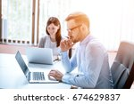 successful workers in office | Shutterstock . vector #674629837