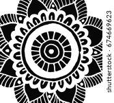flower mandala tile in hand...   Shutterstock .eps vector #674669623