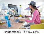female graphic designer working ... | Shutterstock . vector #674671243