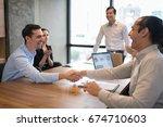 businessman shaking hand after...   Shutterstock . vector #674710603