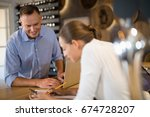 smiling manager and bartender... | Shutterstock . vector #674728207