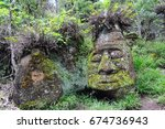 the stone face on floreana... | Shutterstock . vector #674736943