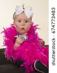 a baby with a shocked... | Shutterstock . vector #674773483