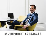 happy man in suit working with... | Shutterstock . vector #674826157